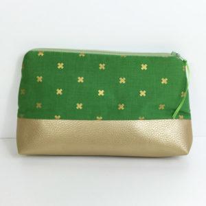 Schminktasche Gold mit Kreuzen auf Grün