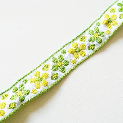 Band mit grünen und gelben Bumen