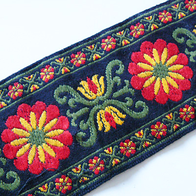 Band breit, schwarz mit großer Blume - Rest